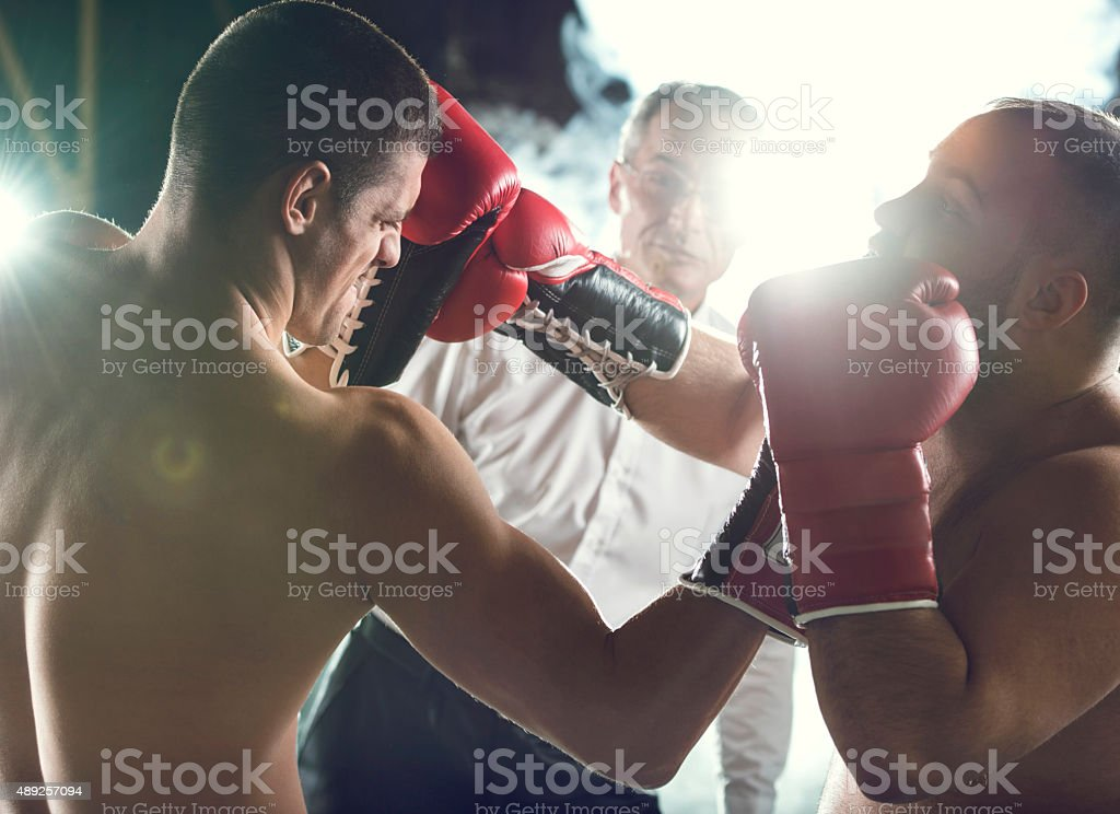 Boxing match in boxing ring. stock photo