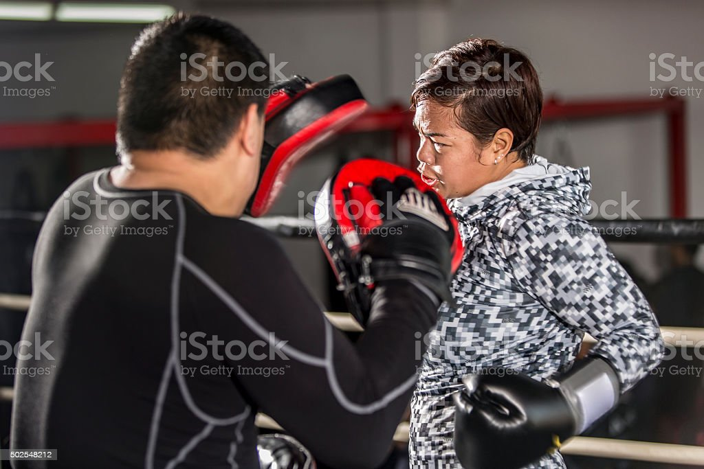 Boxing: Practice training with Punch Pads in a Boxing Ring stock photo