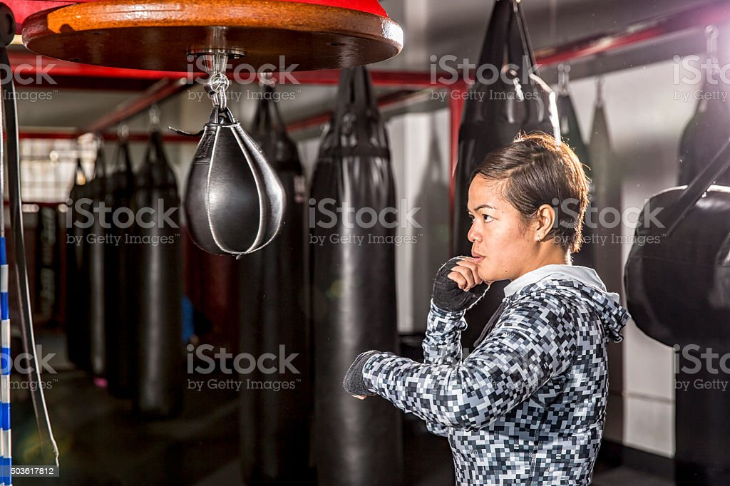 Boxing: Practice with a Speed Bag in a Boxing Gym stock photo