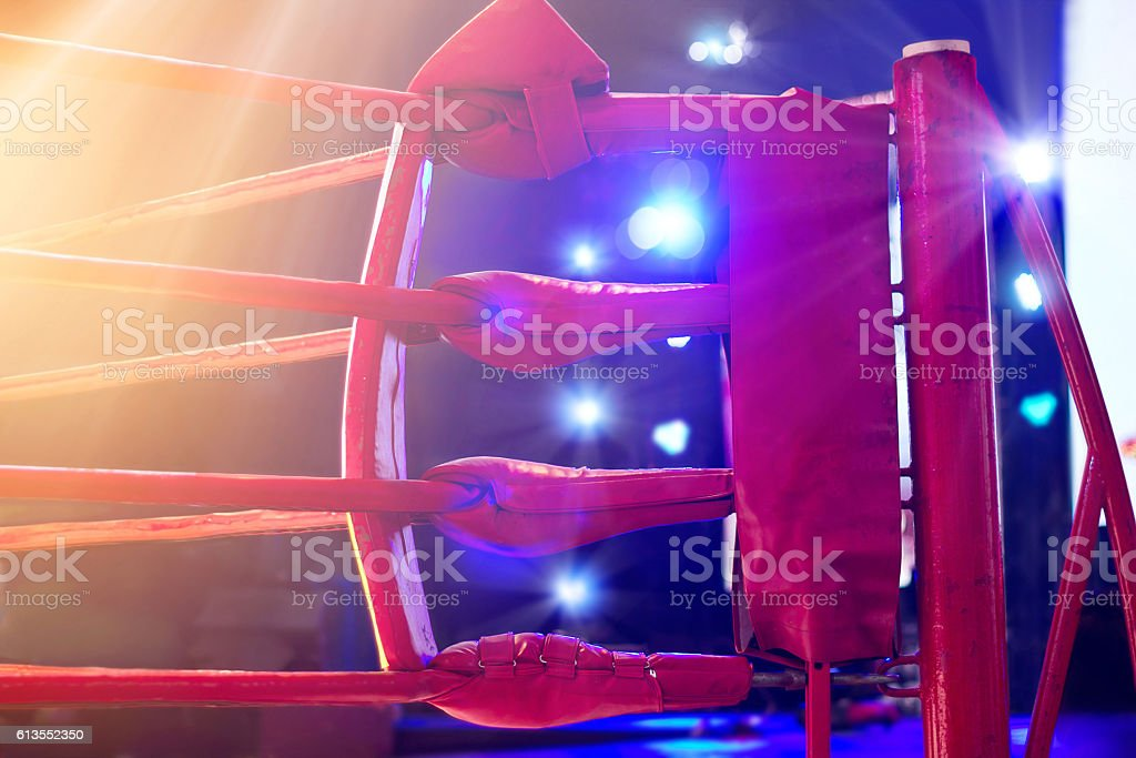 Boxing ring red corner and floodlights, dramatic lighting stock photo