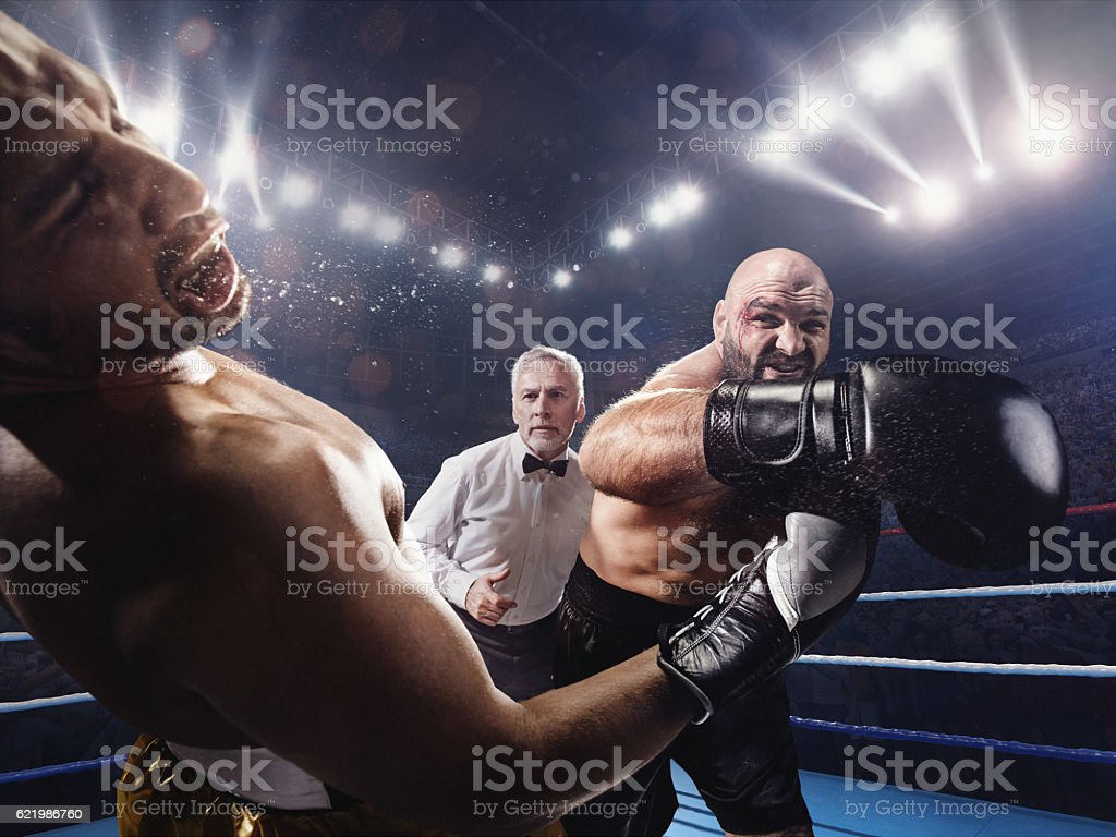 Boxing: Strong kick into the face stock photo