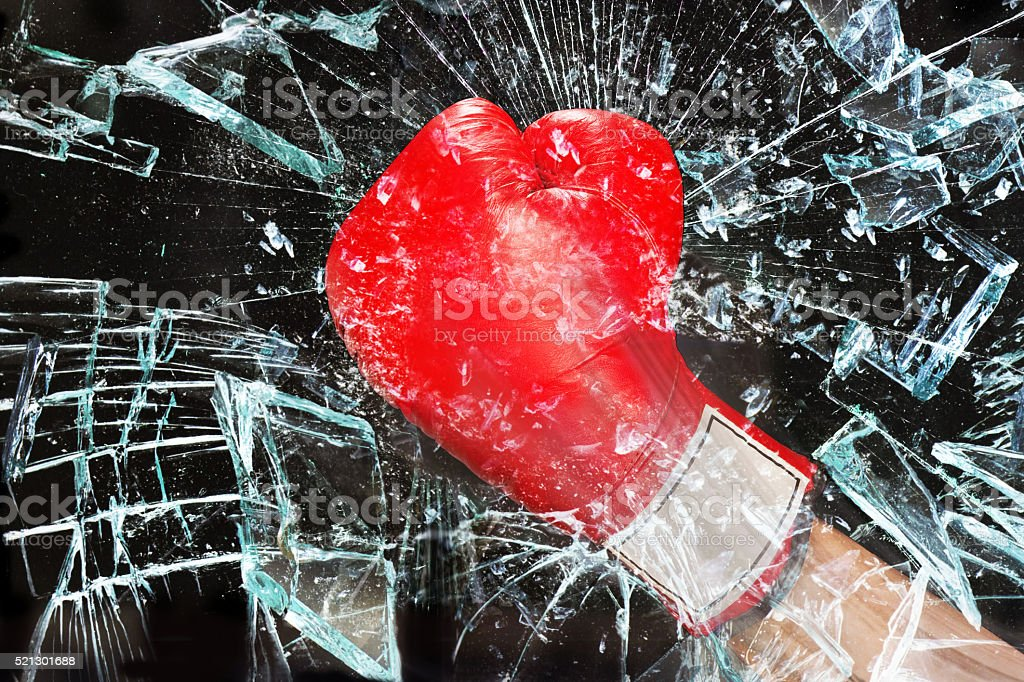 Boxing through glass window. stock photo