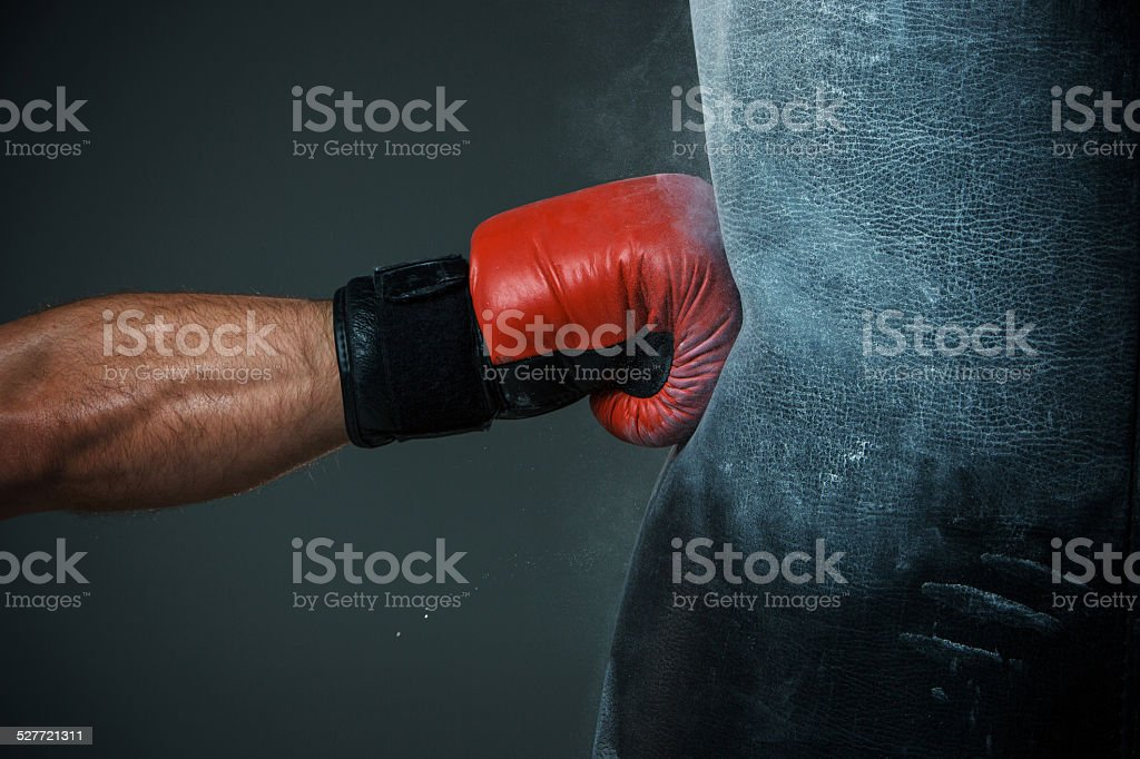 Boxing training and Punching bag stock photo