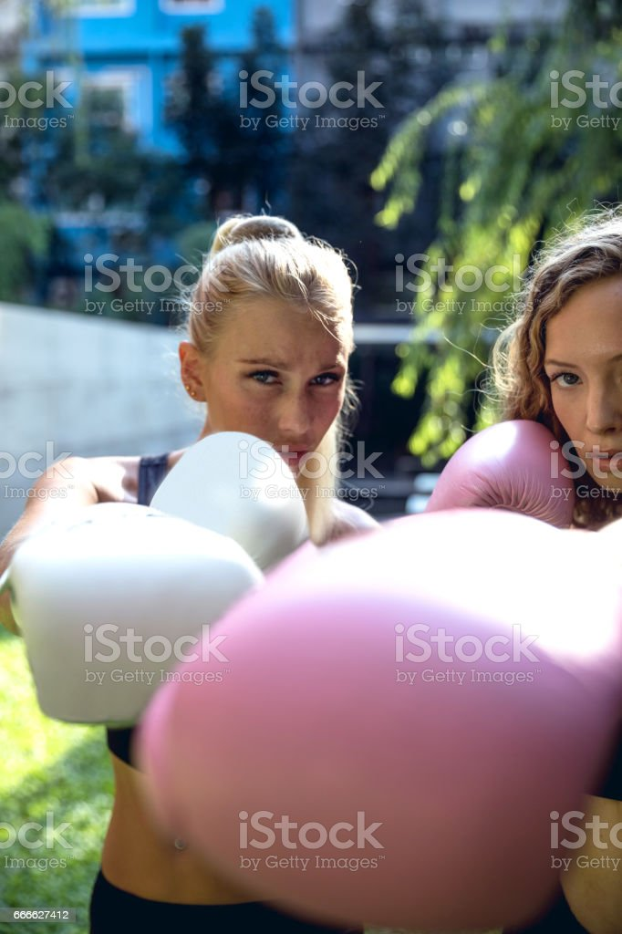 Boxing training outdoor - Sport Concepts - Two women friends working out stock photo