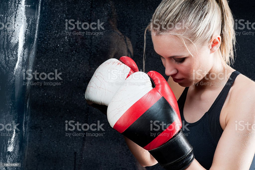 Boxing training woman with punching bag in gym royalty-free stock photo