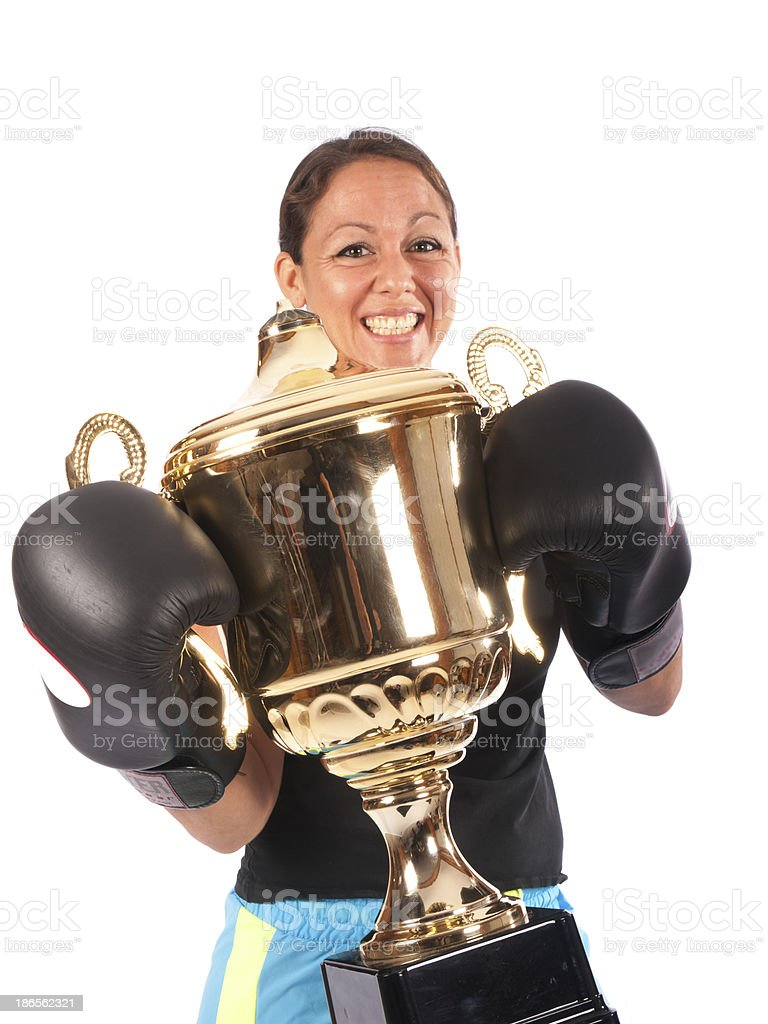 boxing woman with a trophy on white background royalty-free stock photo