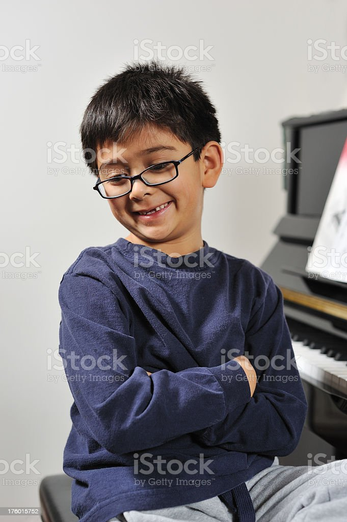 Boy after practicing piano royalty-free stock photo