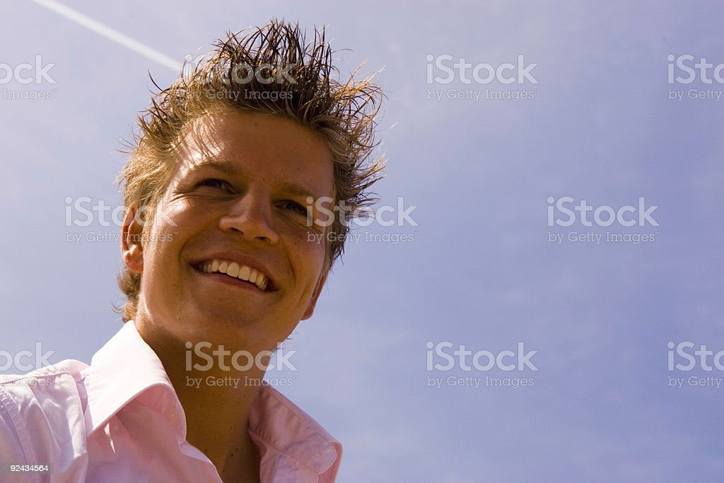 boy against blue sky royalty-free stock photo