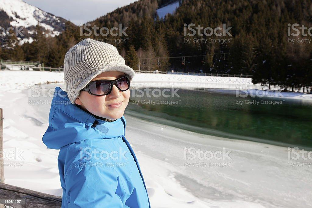 Boy against mountain lake stock photo