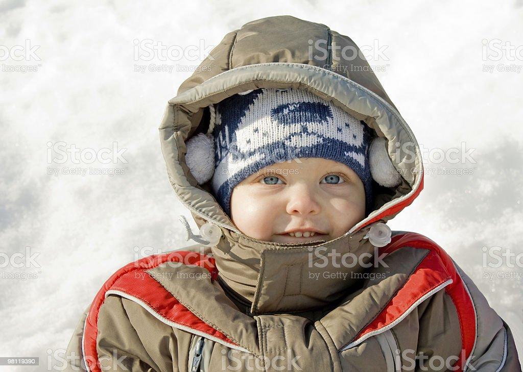 boy against snow stock photo