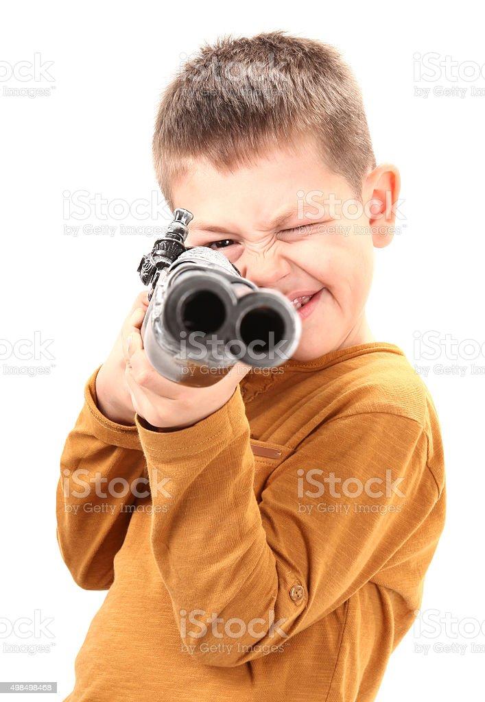 Boy aim with toy gun old rifle stock photo