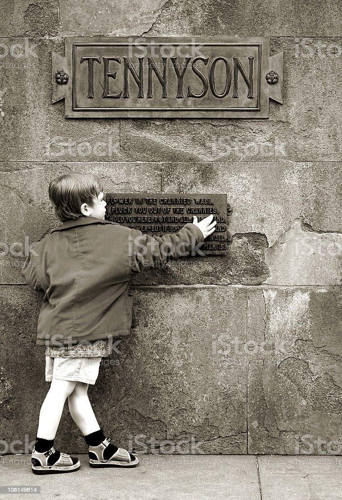 Boy and Alfred Lord Tennyson poetry monument stock photo