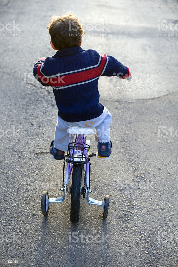 boy and bicycle stock photo