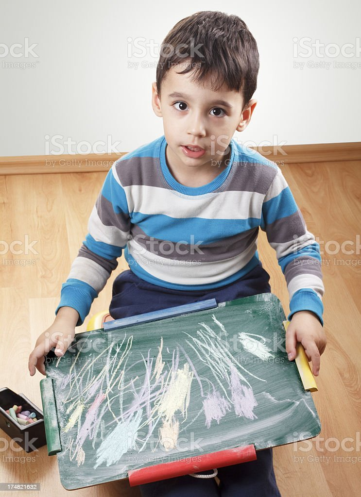 Boy and blackboard royalty-free stock photo