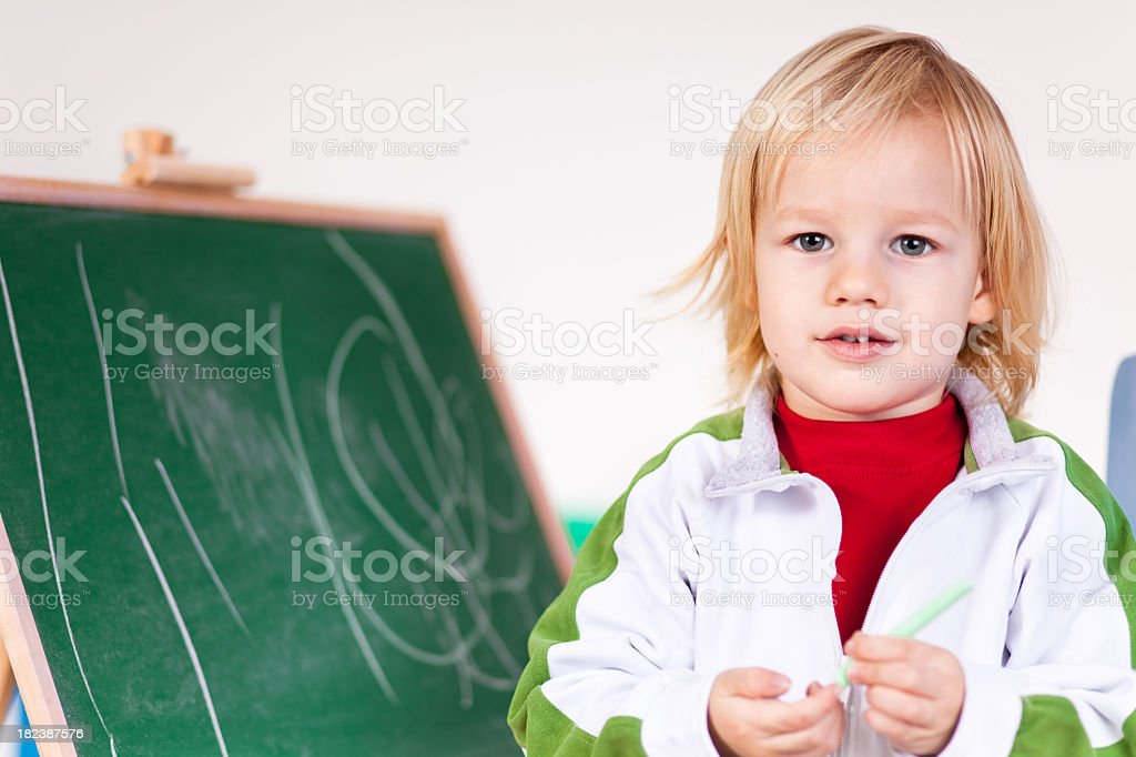 Boy and blackboard stock photo