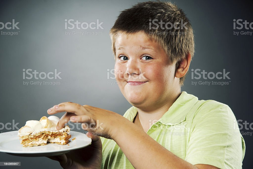Boy and cake royalty-free stock photo