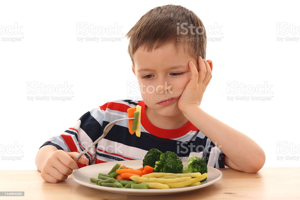 boy and cooked vegetables royalty-free stock photo