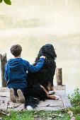 Boy and dog at fishing