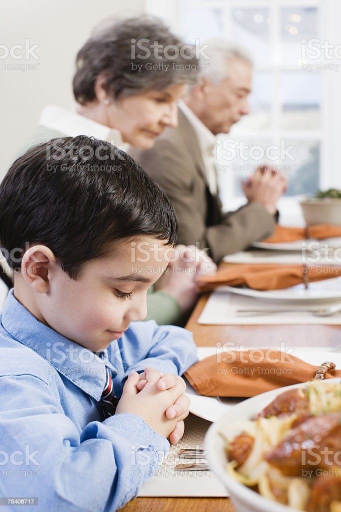 Boy and family saying grace royalty-free stock photo