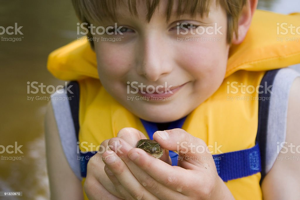 Boy and frog royalty-free stock photo