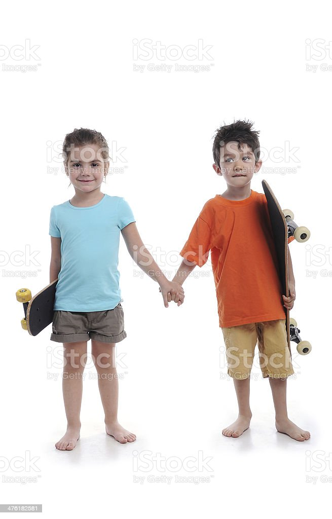 Boy and girl are skaters stock photo