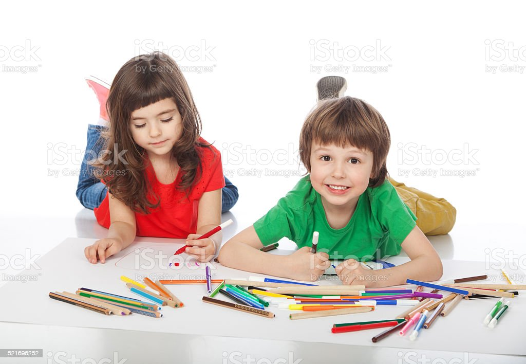 Boy and girl doodling stock photo