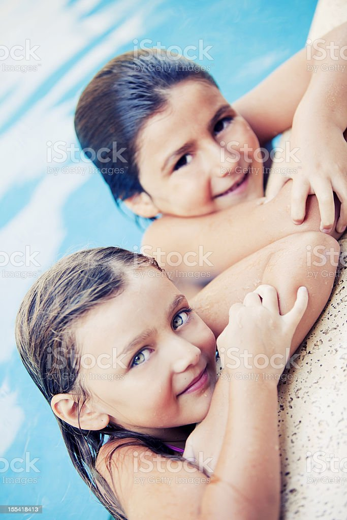 Boy and Girl Having Fun in Swimming Pool royalty-free stock photo