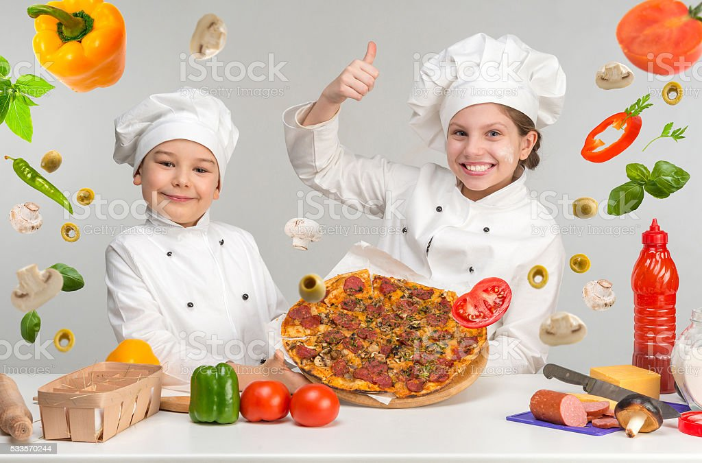 boy and girl in white uniform by the table with stock photo