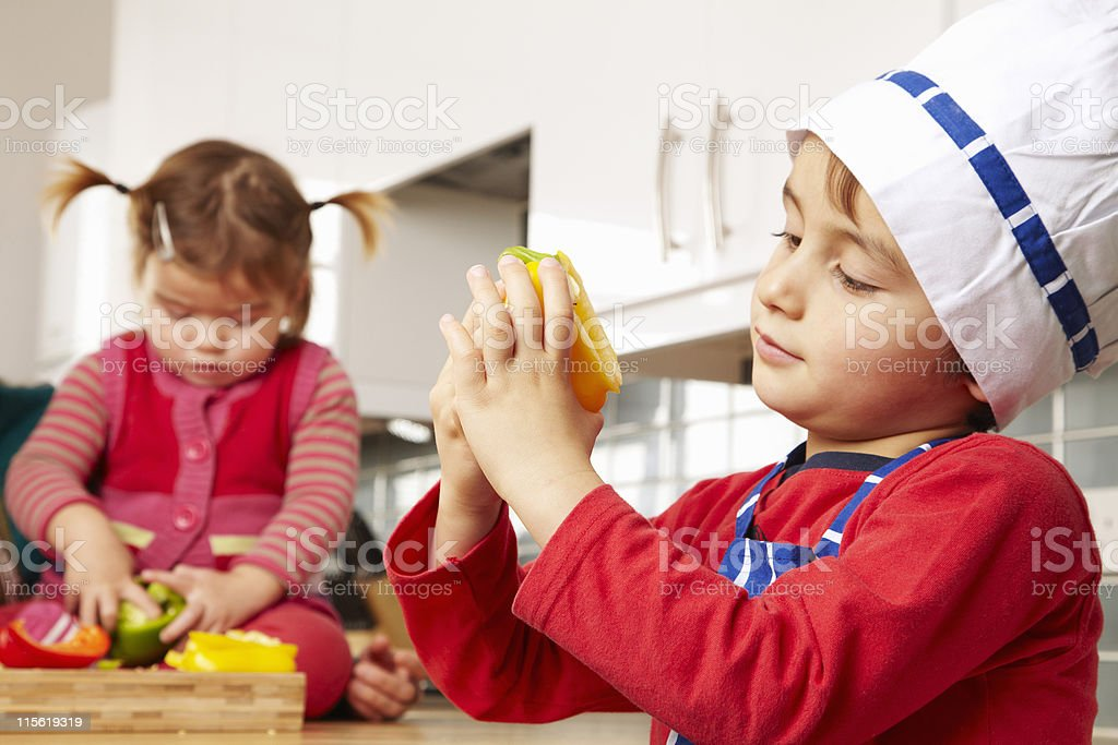 Boy and girl looking at vegetables stock photo