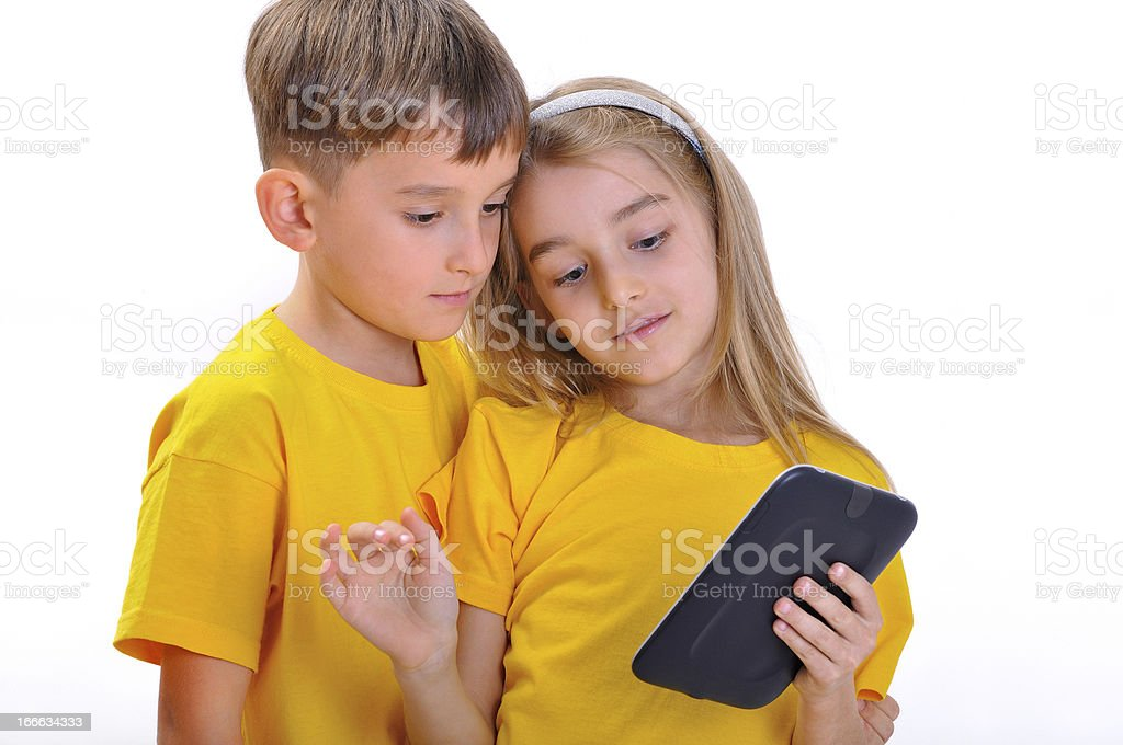 Boy and girl looking e-book royalty-free stock photo