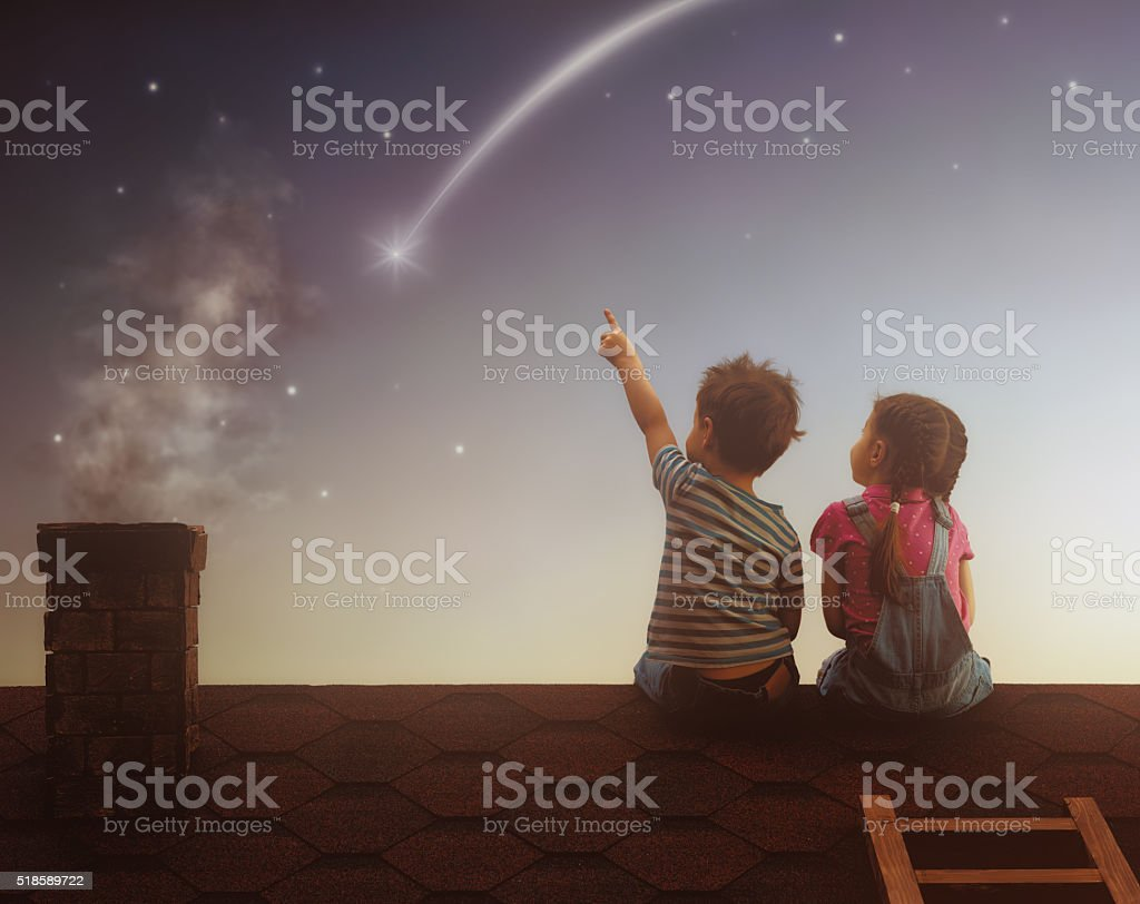 Boy and girl make a wish stock photo