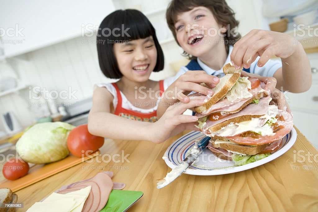A boy and girl making a sandwich royalty-free stock photo