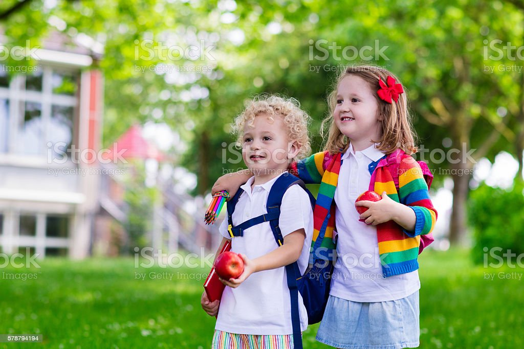 Boy and girl on first school day stock photo