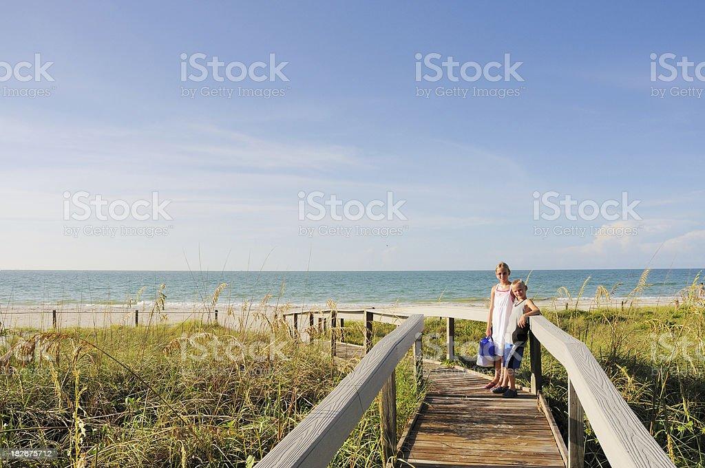 Boy and Girl on Path to Sanibel Island Beach stock photo
