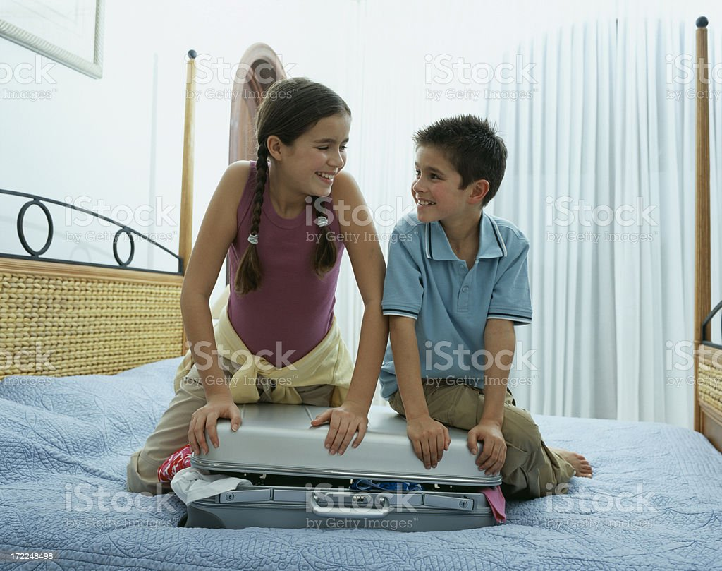 Boy and Girl packing royalty-free stock photo