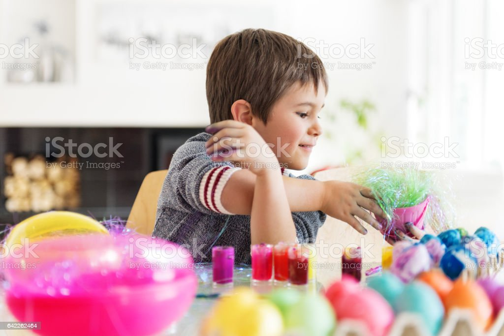 Boy and Girl painting Easter Eggs stock photo