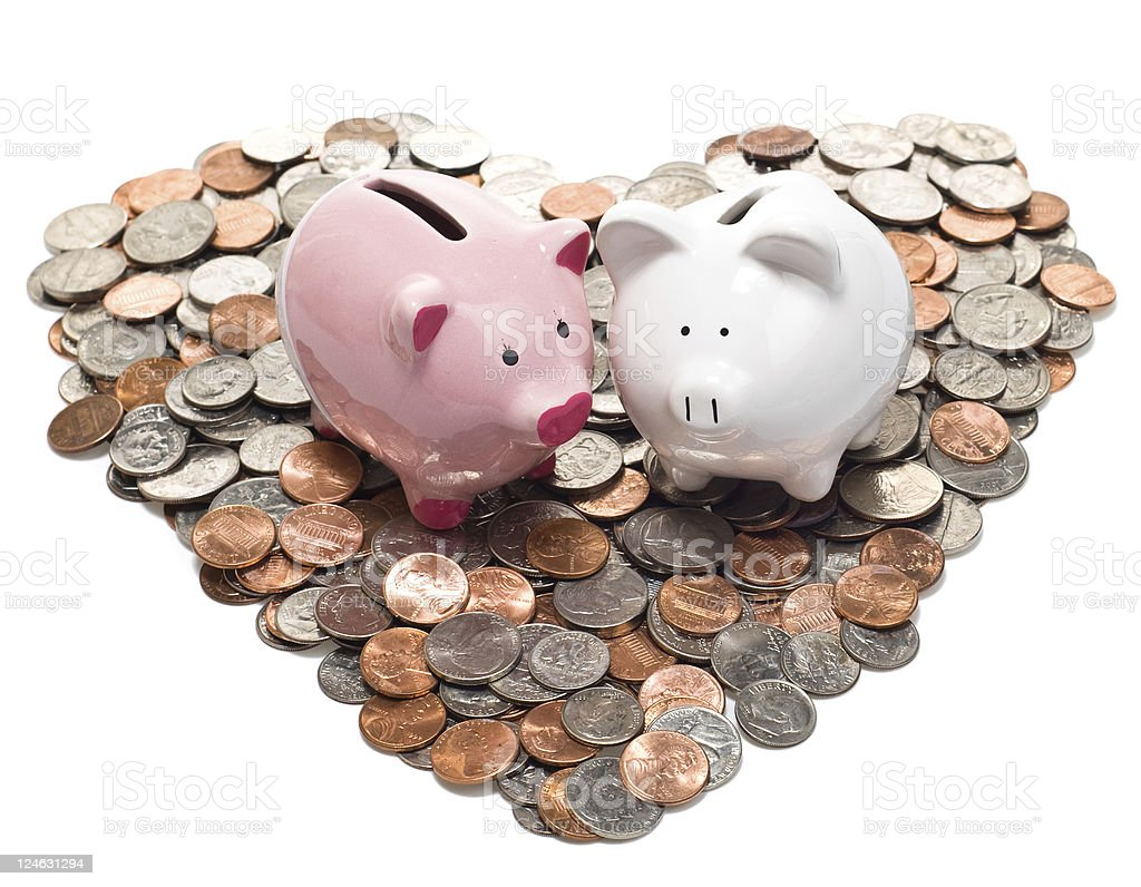 Boy and Girl Piggy Banks on Coin Heart stock photo