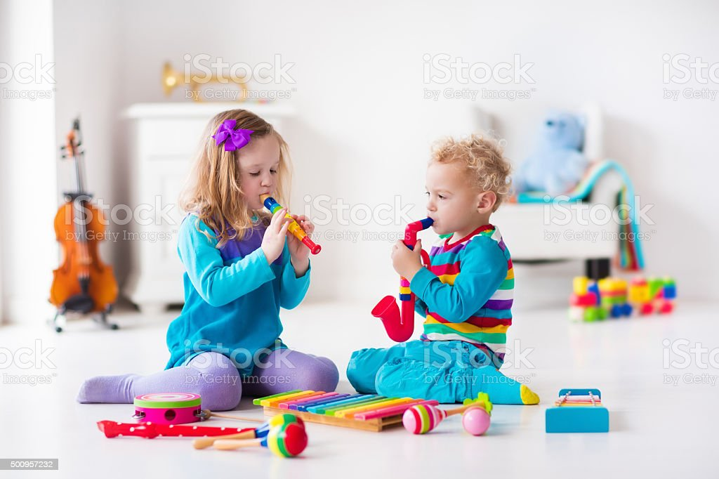 Boy and girl playing flute stock photo