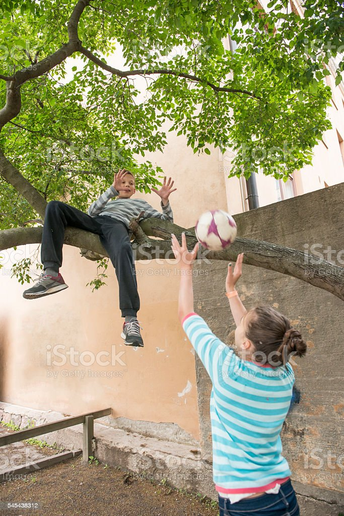 Boy and girl playing with ball. stock photo