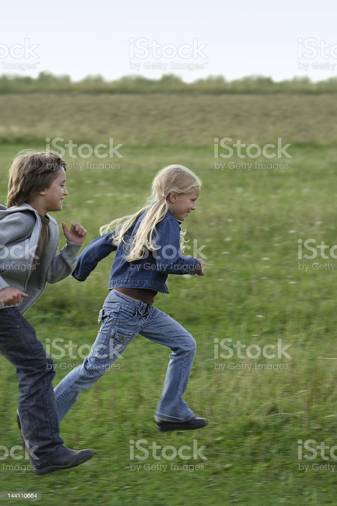 boy and girl running royalty-free stock photo