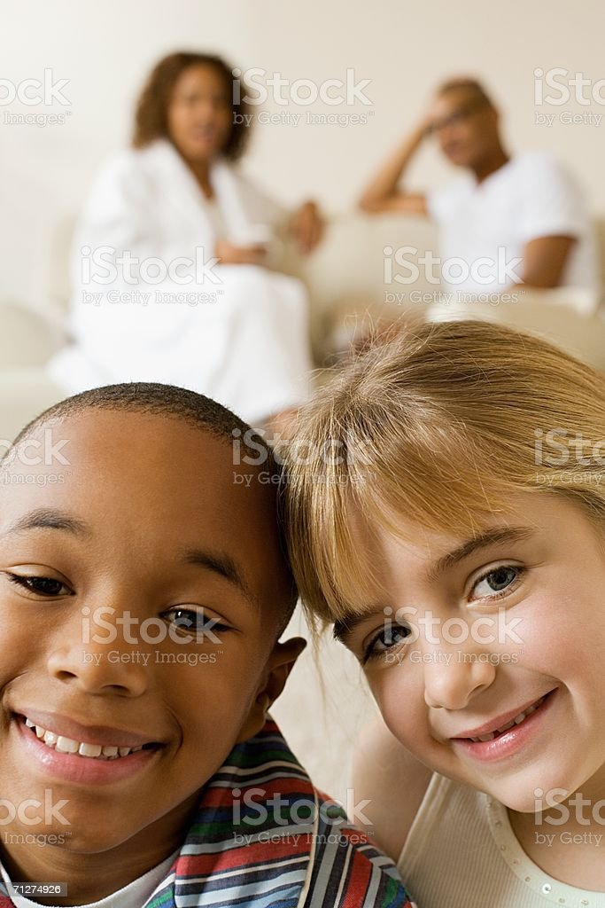 Boy and girl sitting in living room royalty-free stock photo