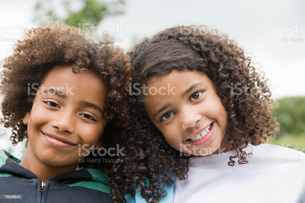 Boy and girl smiling stock photo