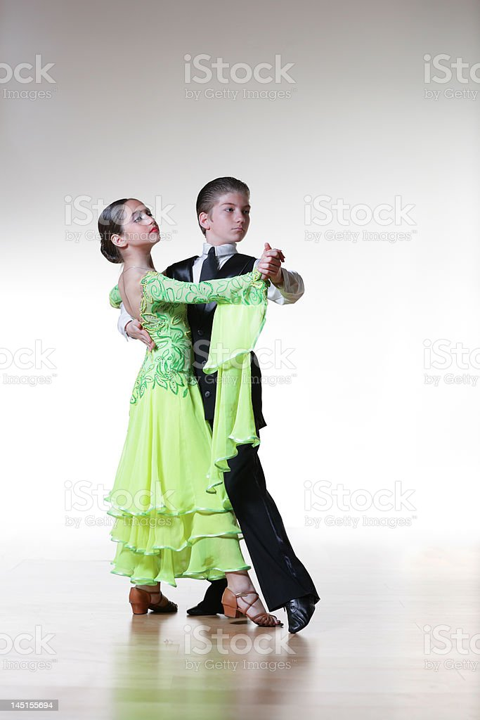 Boy and girl waltzing stock photo