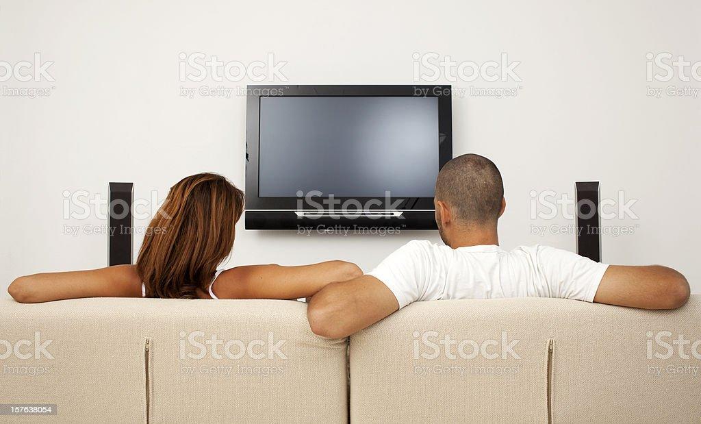 Boy and girl watching TV. stock photo