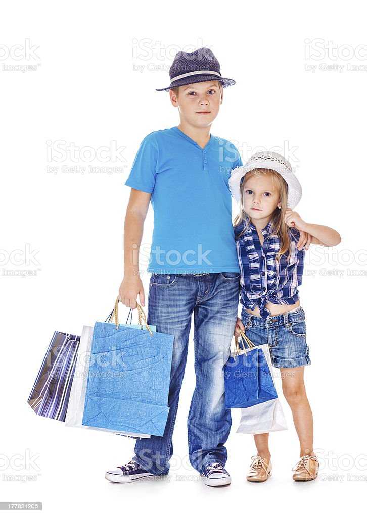 Boy and girl with customer paper bags royalty-free stock photo