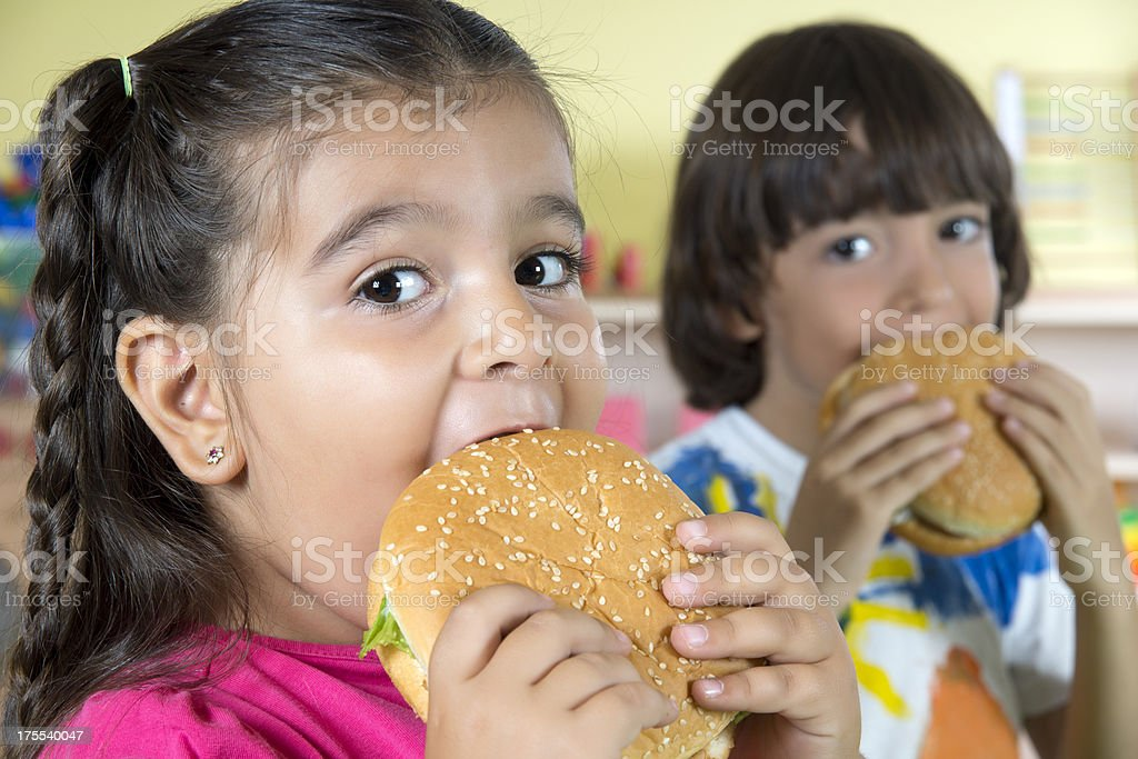 Boy And Girl With Hamburgers stock photo
