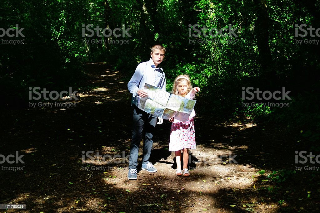 Boy and girl with map royalty-free stock photo