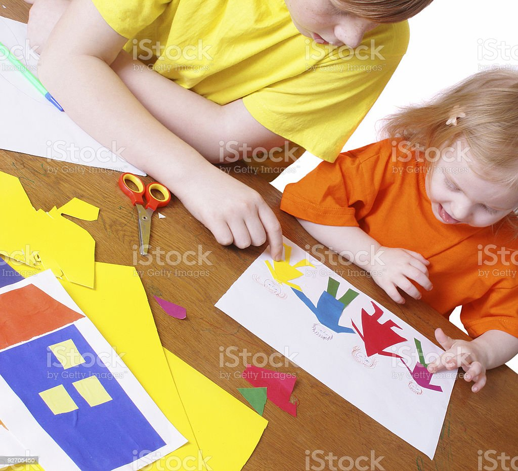boy and girl with paper royalty-free stock photo