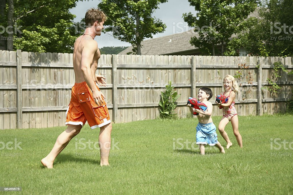Boy and Girl with Waterguns royalty-free stock photo