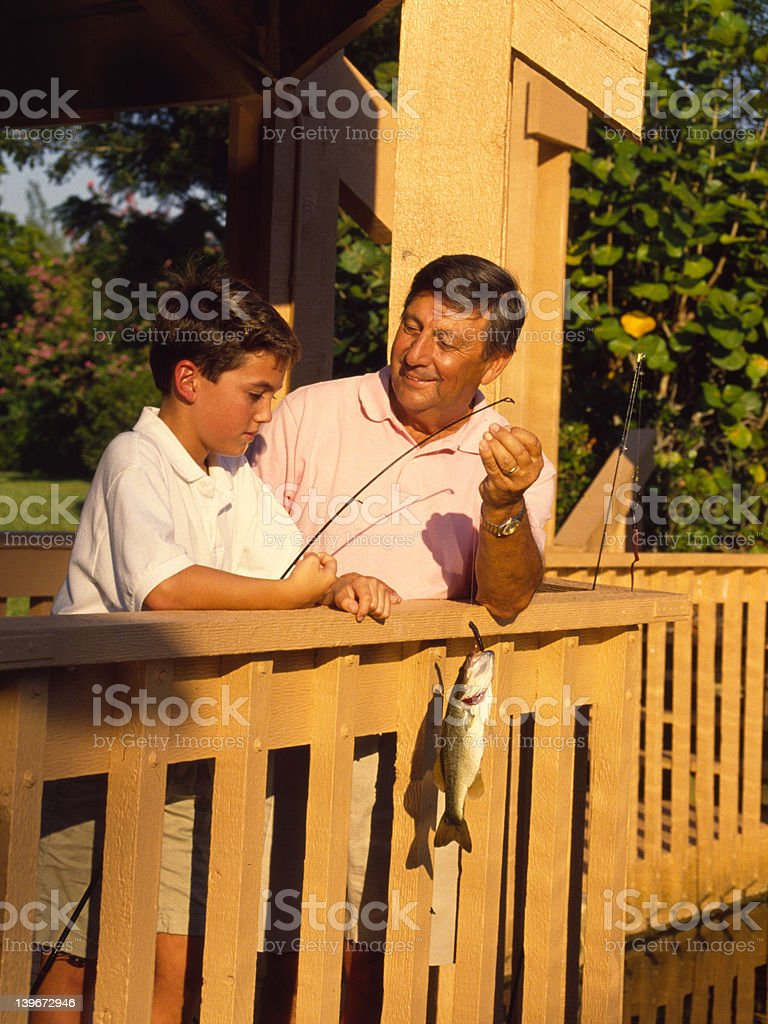 Boy and Grandfather fishing royalty-free stock photo